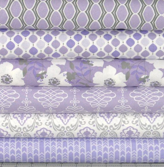 "Six fabrics in pastel lavender, gray, and white from Jack!e Studios Lavishmint collection for Camelot Fabrics. This collection is also available in a gray and a mint green colorway. You can choose from a bundle of fat quarters, or 1/2 yard cuts.  100% cotton quilt store quality fabric 44/45"" width Fat quarter = 18 x 22 1/2 yard = 18 x width of fabric  Back to my shop: http://www.etsy.com/shop/fabric406  Please Like or Follow fabric406 on social media for the weekly specials, newly arrived…"