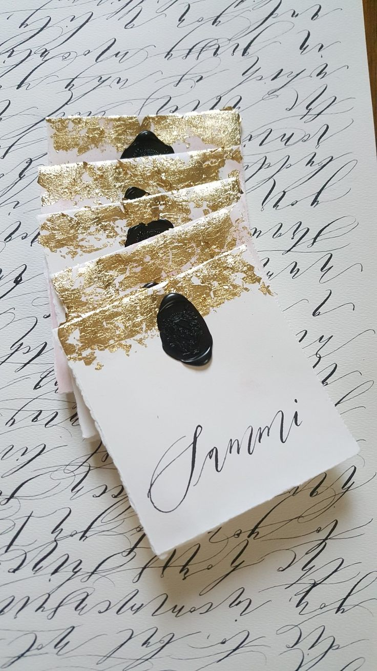 These place names or escort cards are the perfect addition to a sophisticated wedding. A lightly watercoloured background with gold foil, black wax seal and calligraphy. To see more visit instagram @crimson_letters