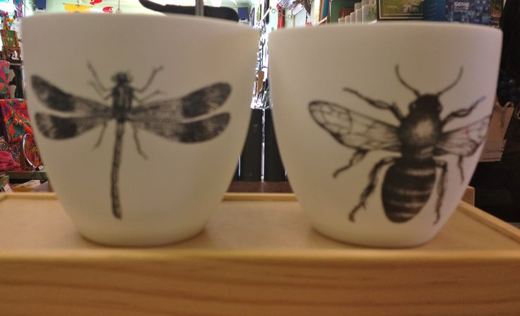 Delicate ceramic votives featuring gorgeous insects.