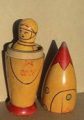 Nesting Russian cosmonauts and rocket.