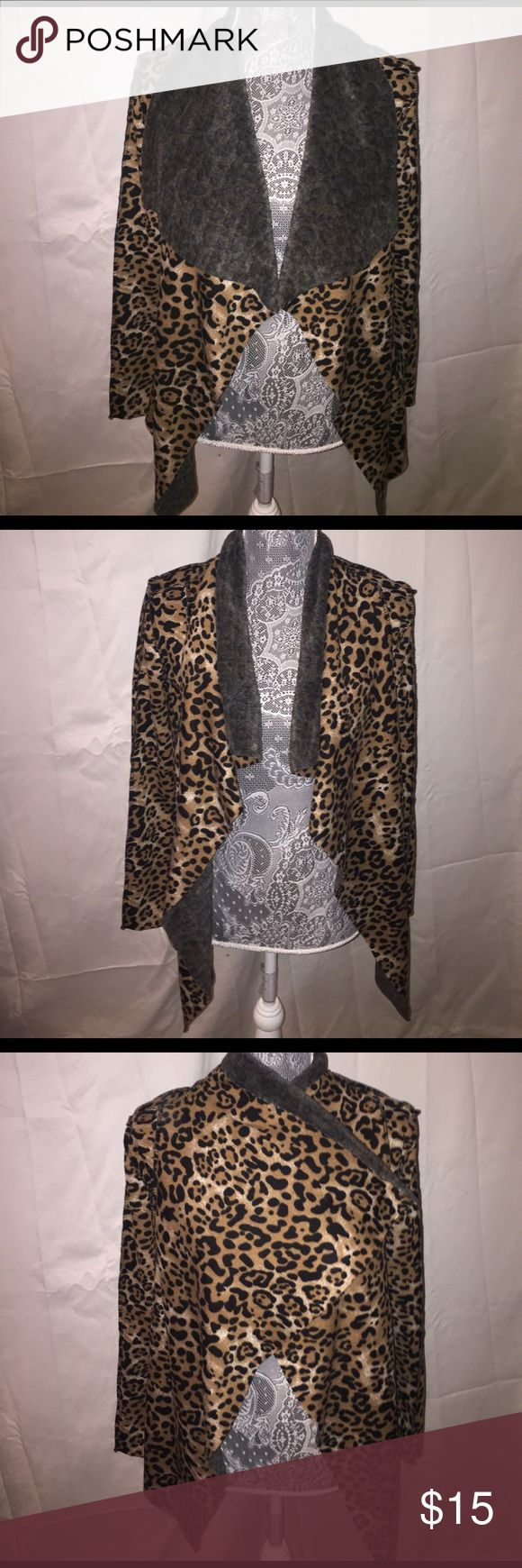 Leopard sweater Velour leopard sweater. No buttons or zippers.super soft and cozy Sweaters