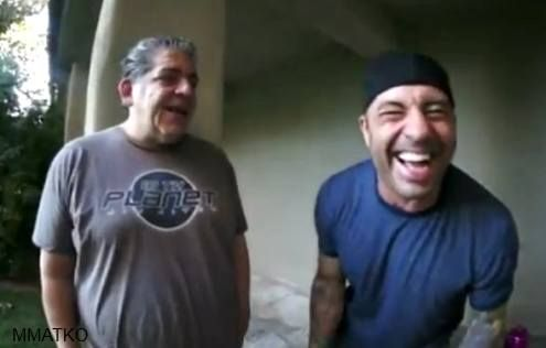Joe Rogan and Joey Diaz laughing and smoking weed