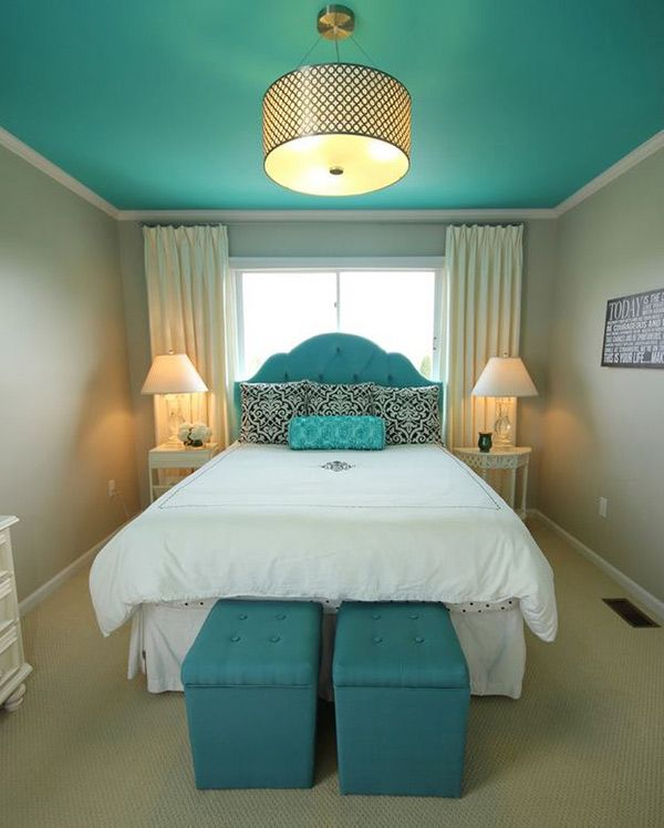 Fashionable Turquoise Bedroom Ideas | Create a beautiful focal point by painting your ceiling with turquoise and keeping everything in white or neutral. It is best accentuated with a chandelier that sparkles like gold to give you a modern glamour.: