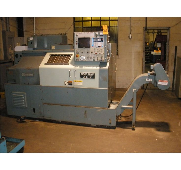 My first CNC, a Mori-Seiki AL2. Mine didn't have a chip conveyor though...