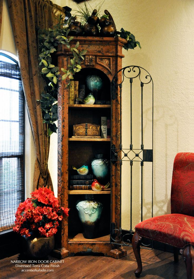 Southwest Red And Turquoise   Showcased By Our Narrow Iron Door Cabinet.  Accents Of Salado Furniture Store