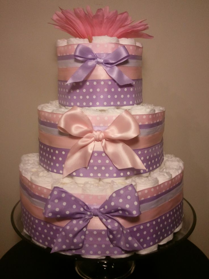 Pink, Purple, And Yellow Diaper Cake