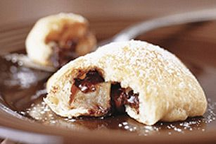 Satisfy your sweet tooth with a chocolate-apple beignet.  Made with refrigerated crescent roll dough instead of homemade pastry, these bite-size pastries are delectably delicious and simple too!