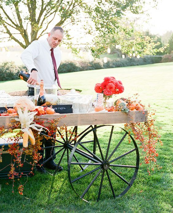 Rustic Wagon Cocktail Bar / http://www.deerpearlflowers.com/wagon-wheelbarrow-country-wedding-ideas/