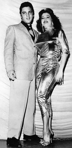 """The King and the Burlesque Queen - Elvis and Tempest Storm - ""After several flashes, I put one hand on the upper part of his bare chest above the opening in his silk shirt. Still, he didn't look at me. I finally called a halt to the picture session and turned to leave. ""I'll see you soon,"" he said as we parted."""