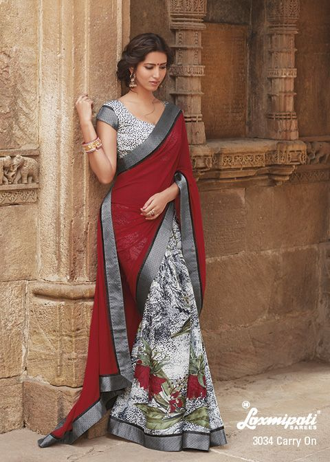 This half-half party wear saree captures a heart by its abstract prints & red pallu.