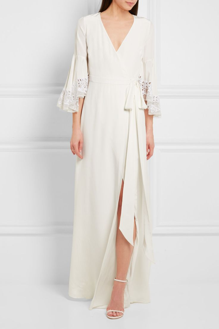 Temperley London's 'Rosemary' gown is crafted from silk crepe de chine with a satin reverse that feels beautifully smooth to wear. It has embroidered tulle-trimmed fluted sleeves embellished with pearlescent beading and an adjustable wrap silhouette that defines your waist. We think it's perfect for brides planning a relaxed country or destination wedding.  Shown here with: Jimmy Choo Sandals, Eddie Borgo Ring.