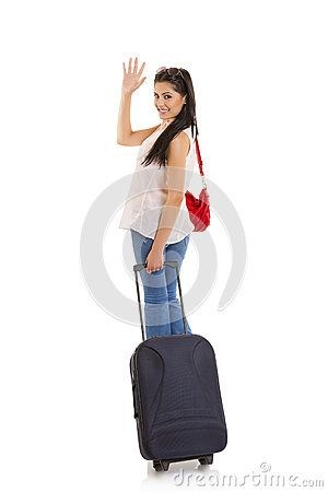 Smiling pretty woman carrying travel suitcase and waving goodbye. Isolated on white.