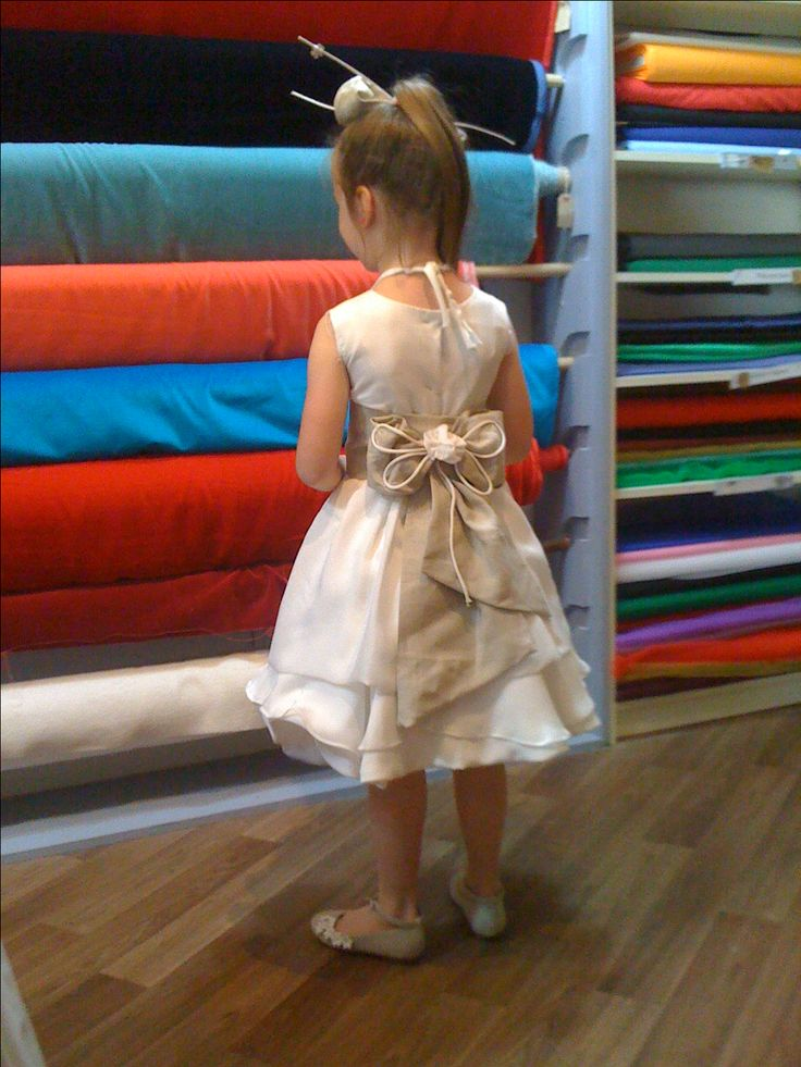 communion dress and head piece made by dress maker Denise Long designer by mother. Silk and linen from CLOTH Dublin