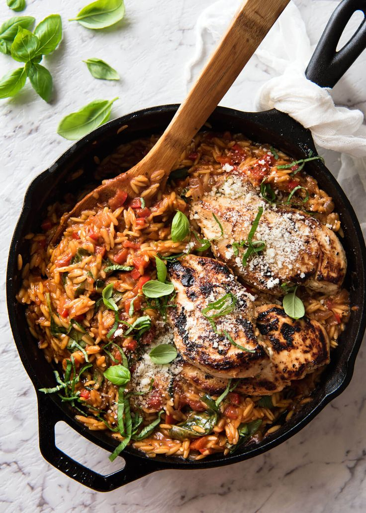 A quick and easy orzo / risoni pasta recipe - chicken infused with Italian flavours and a rich tomato basil risoni, all made in one pot!