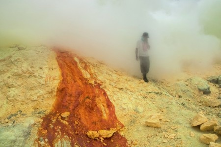 Anggi Anggoman: Besides the sulfur fumes and the steep terrain, its also a challenge for the miners in Ijen crater (Banyuwangi, East Java, Indonesia) to avoid the outbursts of hot liquid sulfur. The hot liquid sulfur could burst unexpectedly and at anytime, and it threatens the safety of the workers.