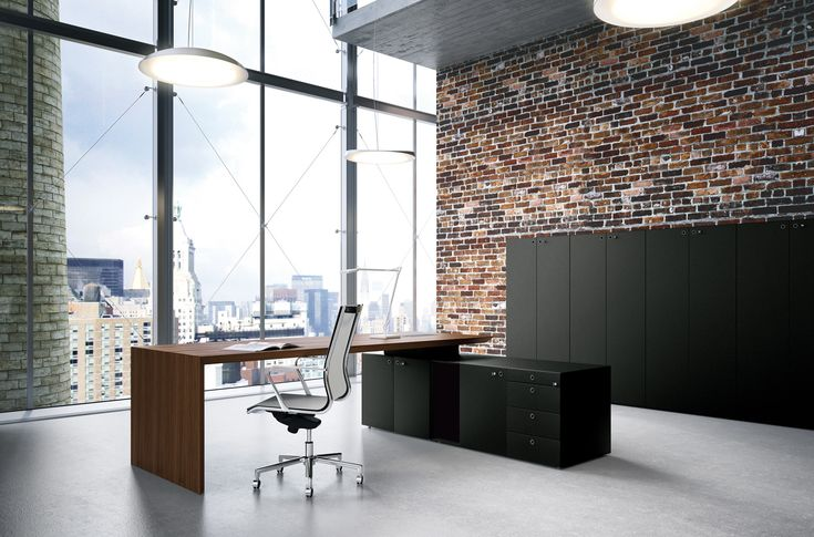 CEO walnut executive desk with black executive high and low office cabinets.