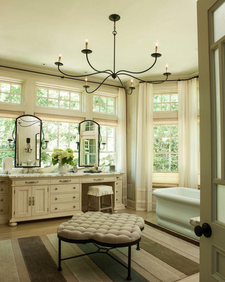 Bay windows brighten this classic master bathroom