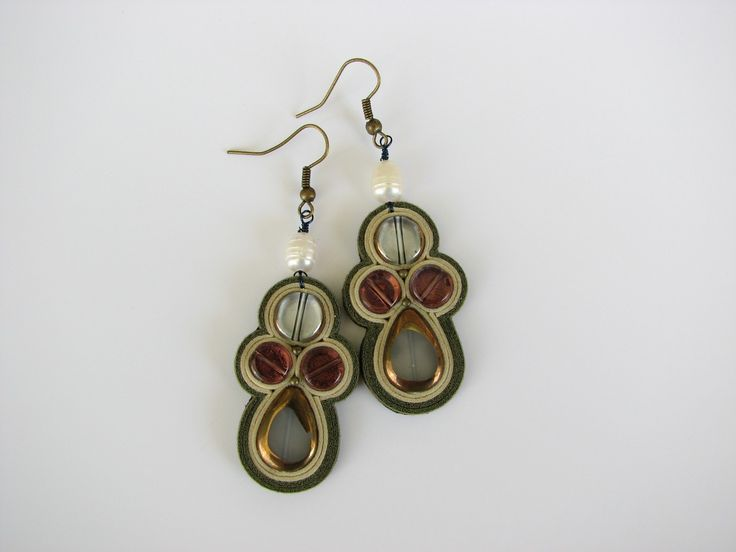 Statement earrings made of fresh water pearl, glass, natural leather, nickel-free metal and gold foil.  www.iasoltanei.ro