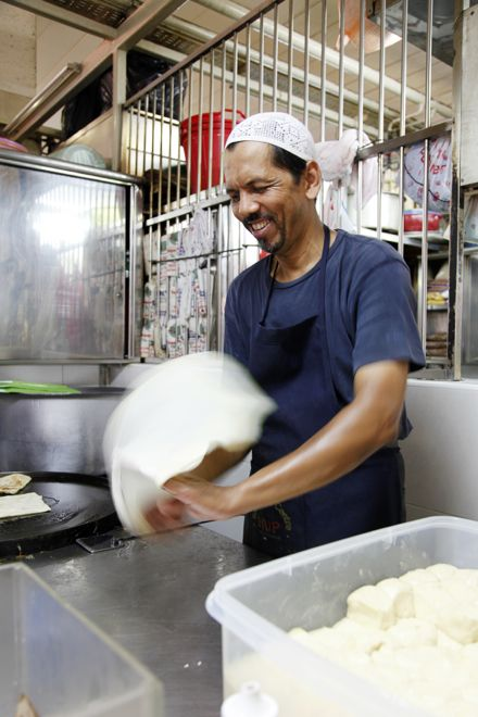"""Did you know that the word """"roti"""" can mean different types of bread depending on which part of Asia you are in? In Southeast Asia roti is not only delicious, watching the dough being kneaded, tossed and stretched is a form of entertainment for kids in itself. Read all about it on our website http://www.suitcasesandstrollers.com/articles/view/asian-street-foods-for-kids?l=all #GoogleUs #suitcasesandstrollers #travel #travelwithkids #familytravel #familytraveltips #traveltips"""