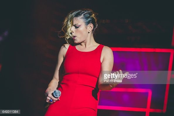Emma Marrone is rocking out in that red dress during her Schiena tour in 2013