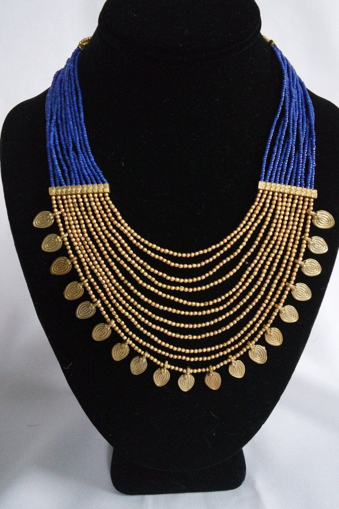 """Handmade necklace by the Naga Tribe in India. This necklace is even more beautiful when worn.11 Tiers that drape down the neck. There is a hook for closure which makes it very easy to close on your own.Measurement: 17 1/4"""" on the shortest strandTotal length of 5 tiers:2 3/4""""Pointed Beads : 3/8"""" x 3/8""""Weight: 65.3 grams * For Silver Color - Silver is painted over brass!"""