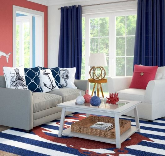Charming nautical living room idea that is perfect for a small space... http://www.completely-coastal.com/2017/06/simple-stylish-coffee-tables-for.html Packs a punch with all the classic nautical colors and patterns!