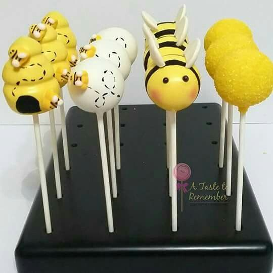 Gender reveal baby bee themed cake pops