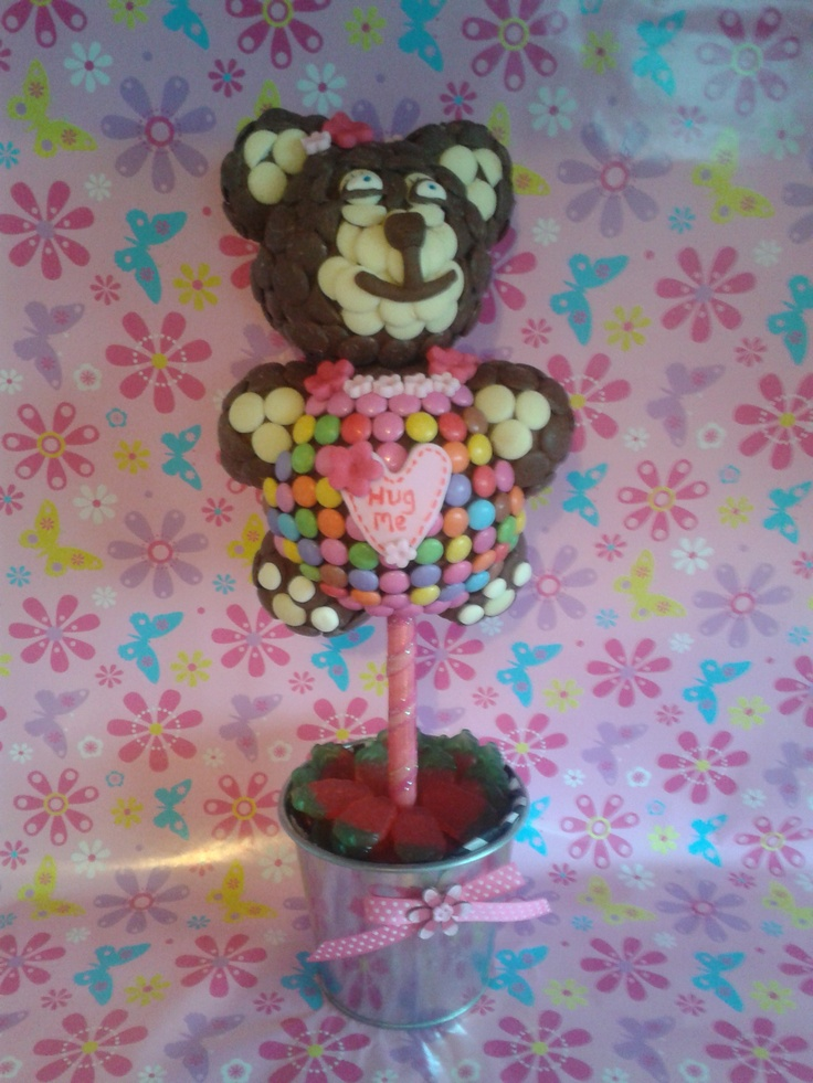 A new design made for a little girl who loves her teddy bears made from milk and white chocolate button,Smarties and finished with edible flowers and hug me love heart