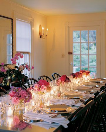 marthas dinner party table set with pink flowers and candles. perfection