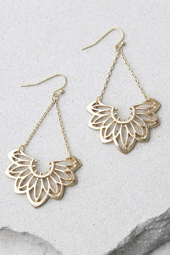 "Add a little floral flair with the Flourish Gold Earrings! Dangling shiny gold earrings with a floral motif. Earrings measure 2""."