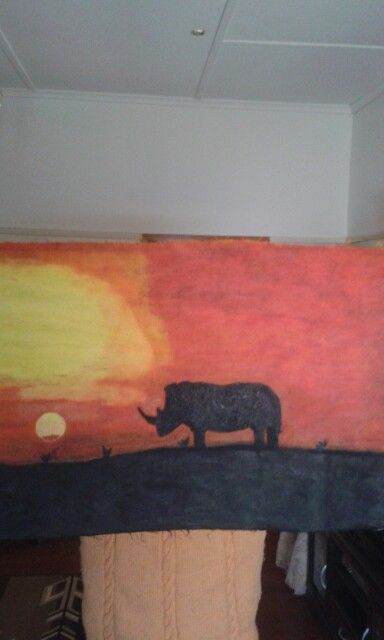 Rhinoceres in the sunset. Oil paint on canvas. Artist is Charl Blignaut (Blikkies). 2015