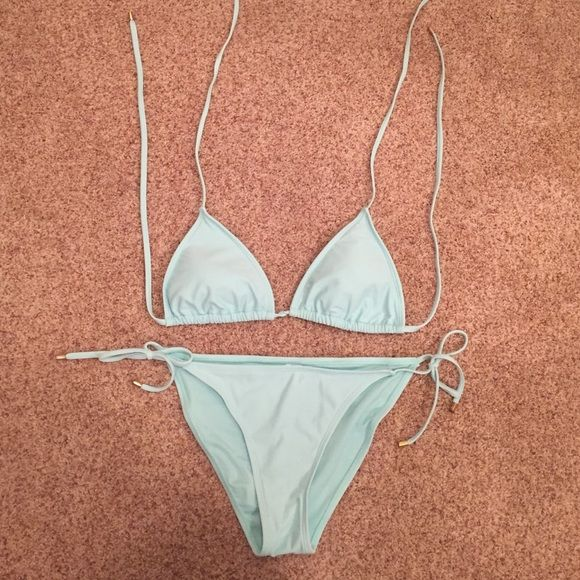 L Mint Bikini L mint bikini from Forever 21. Each string has gold ends as shown and it fits more like a medium than a large but it can still fit as a large. Lightly worn with no stains. Forever 21 Swim Bikinis