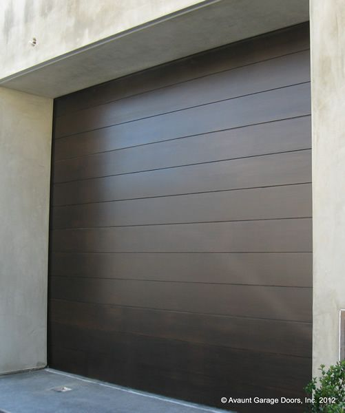Full custom stain grade wood garage door in clear western red cedar. 8'x7'