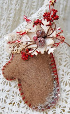 DIY Crafting - An Unusual Way to color Felt! Cream coloured felt cut into mitten shape, blanket-stitched together and top tied with candycane string - aged with coffee grounds. Tutorial follows re: how-to for sugared jingle bells