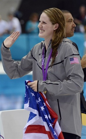 Swimming: Day 3 Finals - Swimming Missy Franklin USA waves to the crowd after winning a gold medal in the women's 100m backstroke final