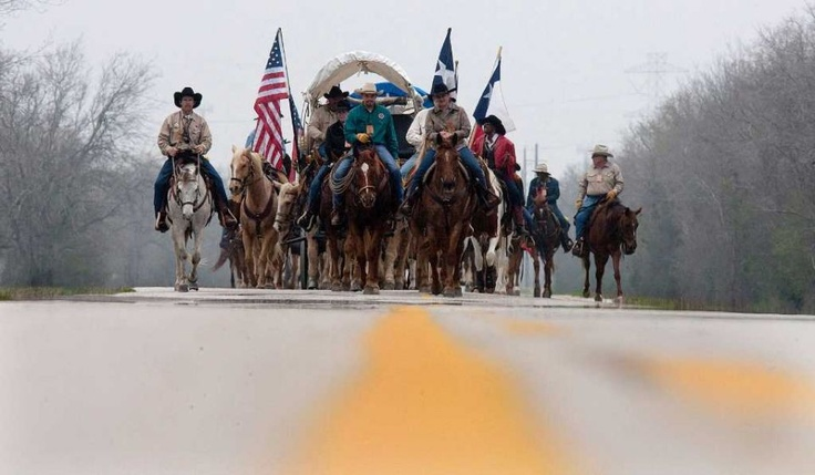 The Valley Lodge trail riders, from Brookshire, make their way down Barker Cypress Rd. on their 71 mile journey to Houston, Thursday, Feb. 23, 2012. The group, which has 100 riders, was established in 1959.    Photo By Johnny Hanson/Houston Chronicle