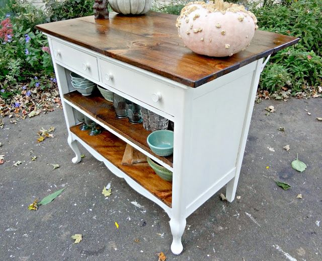 antique dresser repurposed as kitchen island with overhang for seating!