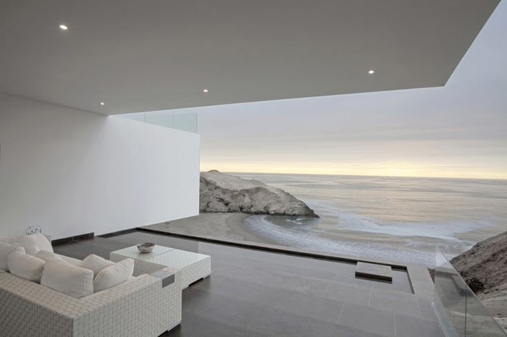 This contemporary view house designed by architecture firm TDC is located in Lima, Peru, overlooking a serene shoreline shimmering with waves. It's this coastal setting that truly sets the tone...