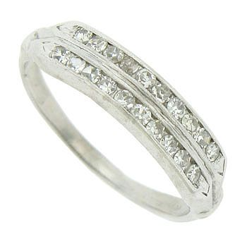 A double row of fine faceted diamonds are bezel set into the face of this antique platinum wedding band. The Art Deco wedding ring measures 4.69 mm in width. Circa: 1930. Size 6. We can re-size.