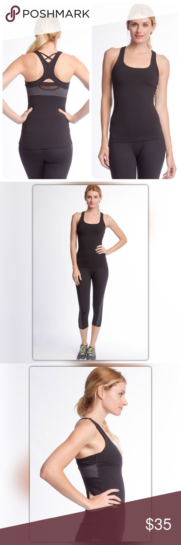 Black and Gray Athletic Tank Top Black never looked so good! This athletic tank has a racer back with straps and a charcoal band. It is made of 87% nylon and 13% spandex for comfort and support. The NEW Boutique Tops Tank Tops