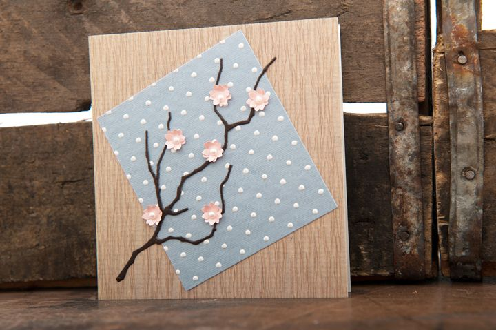 Japanese inspired invitation with branch detail and small pink 3D flowers