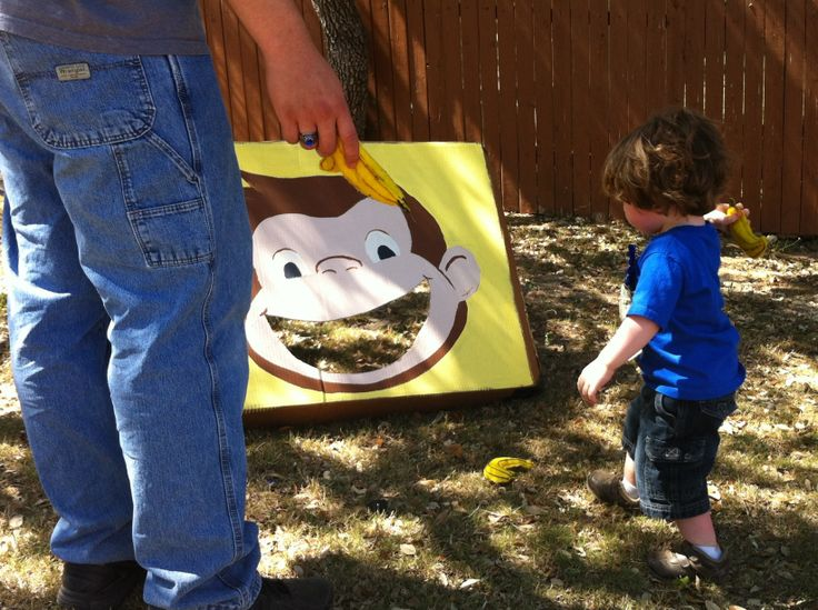 Feed George some bananas game.. Made banana shaped bean bags out of yellow felt and painted George on an old cardboard box. We also did uh oh the monkey has lice game with brown bath rugs and rice kids picked out (the lice) and whoever filled their cup the most in 20 seconds won