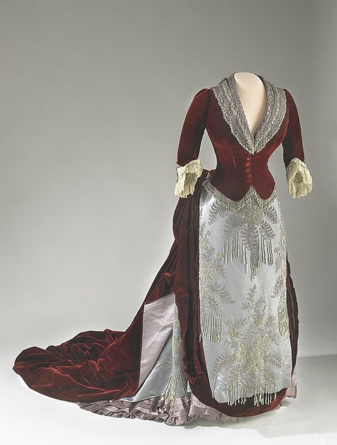 Caroline Harrison's Evening Gown. Burgundy velvet and gray satin evening gown embroidered in a floral design with gray pearls and steel beads. The dress was later altered by a family member.