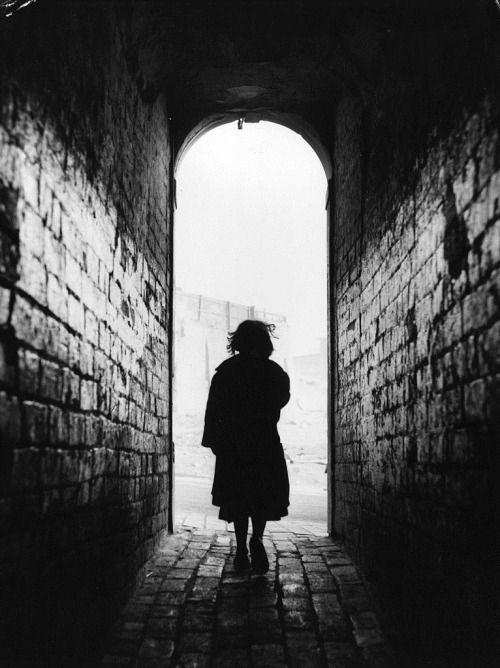 m3zzaluna:  dark passageone of the dark passages which separate birmingham's tunnel-back houses, february 6, 1954. © bert hardy.