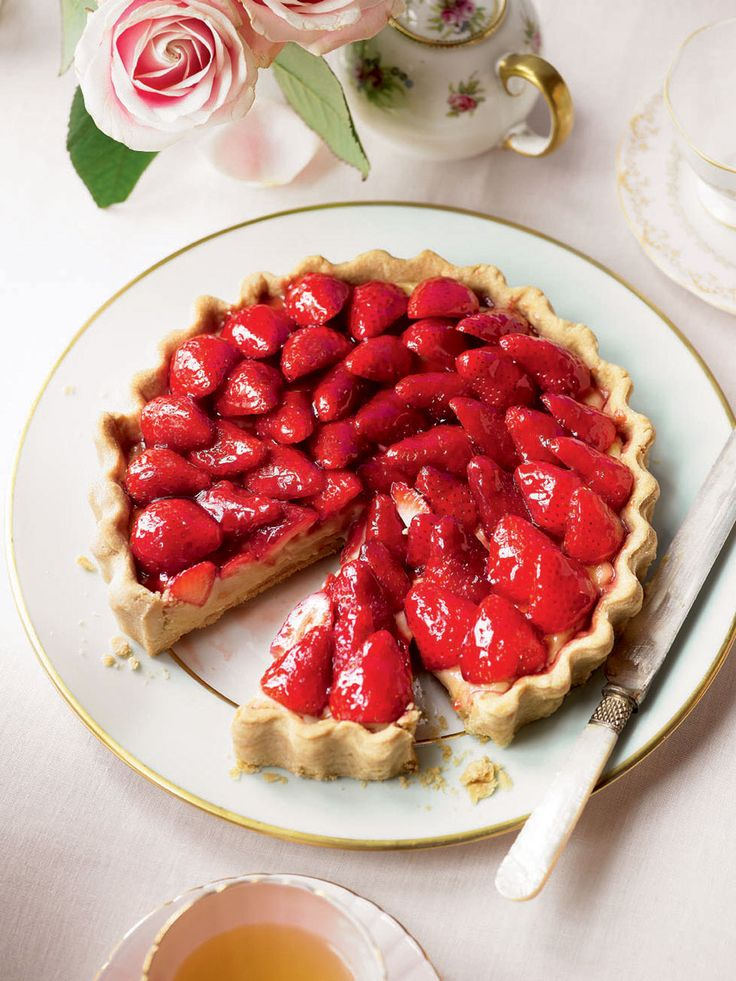 A beautiful strawberry tart recipe made with a shortcrust pastry case with crème pâtissière and glazed strawberries. Perfect for a summer afternoon tea in the garden.