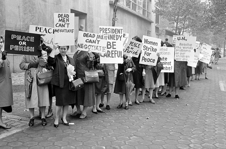 Members of Women Strike for Peace carry placards outside the United Nations headquarters in New York City, where the U.N. Security Council considers the Cuban missile crisis in a special meeting, on October 23, 1962.