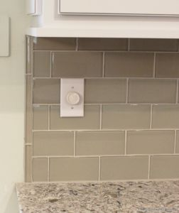 pencil rail caps off the end of a glass subway tile backsplash - Subway Glass Tiles For Kitchen