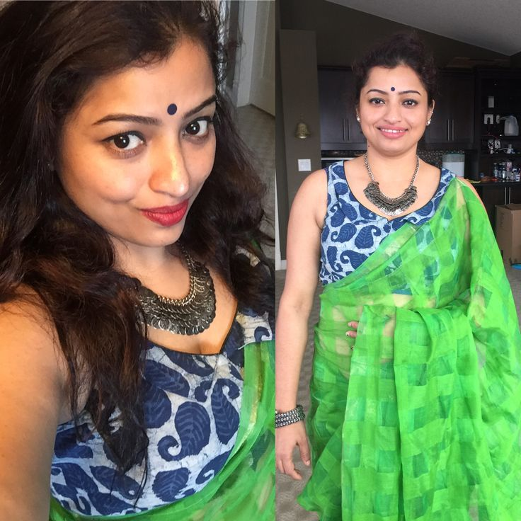 Green handloom saree with a indigo blouse with minimum make best for an afternoon get together