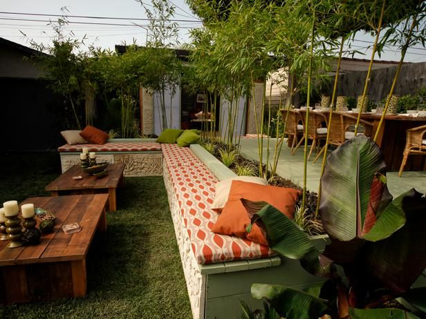 Low benches adorned with custom-designed stone slabs helped transform the large, plain, yard into a Balinese paradise, as seen on The Outdoor Room by Jamie Durie on HGTV.