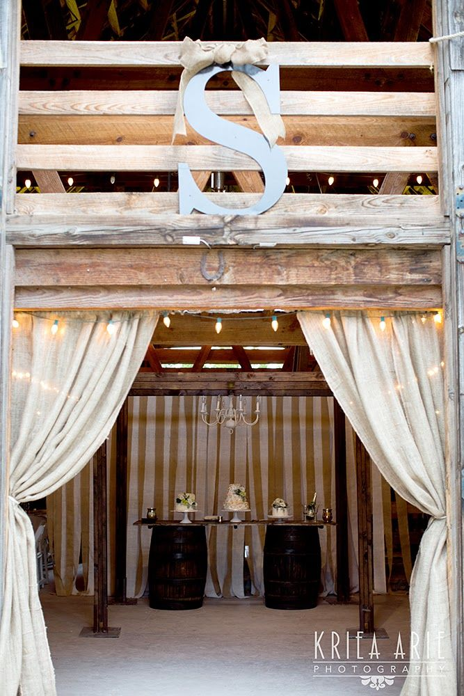 Sue U0026 Lou Events  Barn Doors With Burlap Curtains Framing Cake Table On  Barrels And